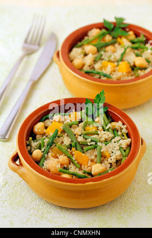 Couscous with chickpeas and wild asparagus. Recipe available. - Stock Photo