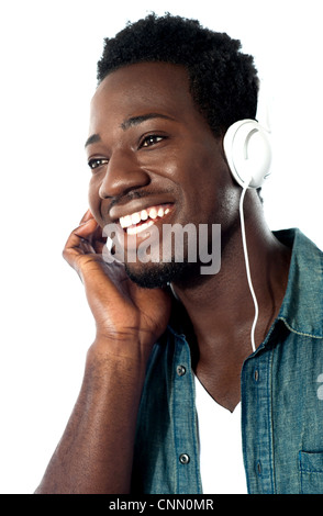 Young man with headphones enjoying music - Stock Photo