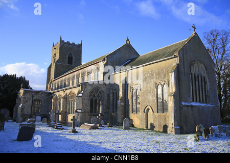 Medieval church and graveyard in snow, St. Mary's Church, Bacton, Suffolk, England, november - Stock Photo