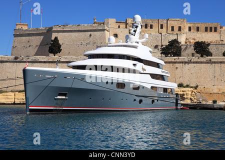 Super Motor yacht Aviva, owned by Joe Lewis, in Valletta harbour Malta, Europe - Stock Photo