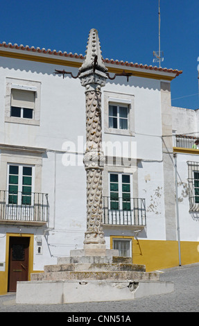 Pillary in small town square used in early times to hang people up punishment Elvas Portalegre District Alentejo - Stock Photo