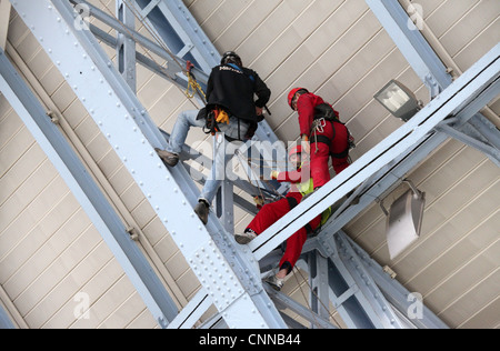 Workmen in the roof at Saint  Pancras Station in London - Stock Photo