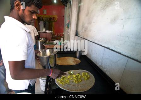 Masala Dosa preparation in a small hole in the wall restaurant in Kandy, Sri Lanka. - Stock Photo