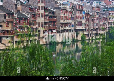 Traditional houses along Wuyang River, Zhenyuan, Guizhou, China - Stock Photo