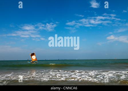 A beautiful catamaran sail boat sailing the ocean near Negombo beach, Sri Lanka. - Stock Photo