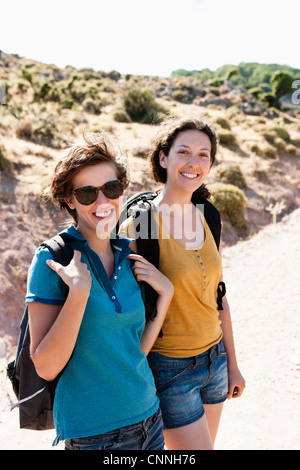 Women hiking together on hill - Stock Photo