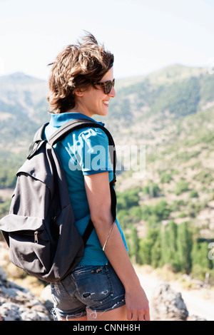 Woman overlooking landscape from hill - Stock Photo