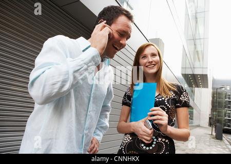 Business people talking on street - Stock Photo
