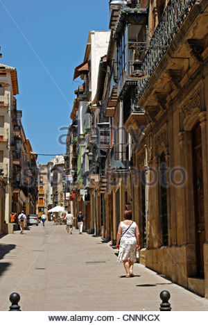Old stone houses and shops in narrow street, Ubeda, Jaen Province, Andalucia, Spain, Western Europe. - Stock Photo