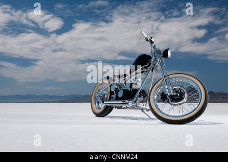 Bonneville Salt Flats bike week retro motor bike racing in USA, motor bike parked on white salt flats - Stock Photo