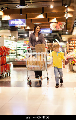 Woman grocery shopping with son - Stock Photo