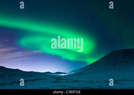 Aurora Borealis and Imagine Peace Tower, Videy, Kollafjordur Bay, Iceland - Stock Photo