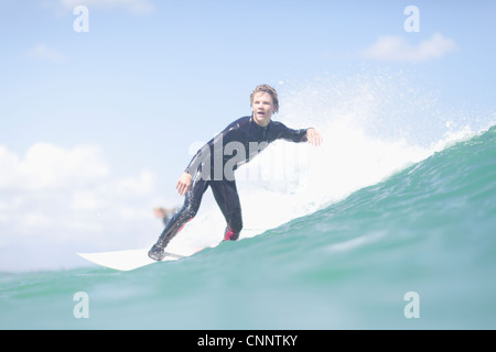Teenage surfer riding a wave - Stock Photo