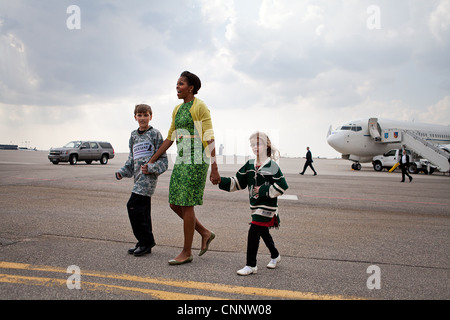 First Lady Michelle Obama walks across the tarmac with Megan Soukup, 9, and Joseph Hudella, 10, participants in - Stock Photo