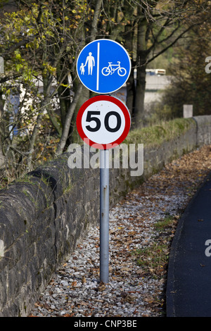 Footpath, cycle lane and 50mph speed limit roadside signs, England, november - Stock Photo