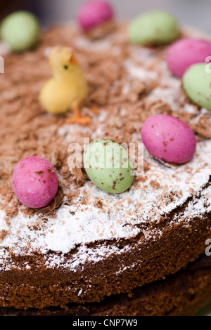 A chocolate cake decorated with mini eggs for Easter celebrations. - Stock Photo