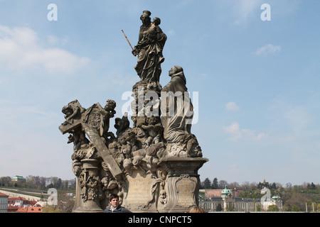 A Religios Statue on Charles Bridge Prague. - Stock Photo