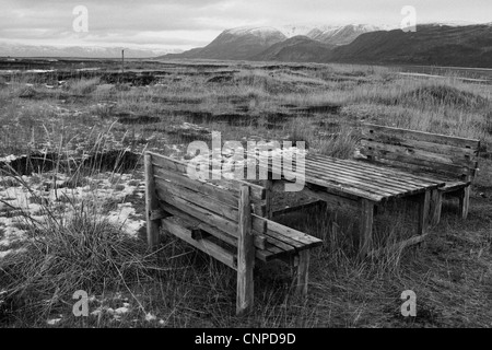 A lonely picnic bench inside the Artic Circle of Norway. - Stock Photo