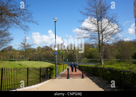 men walking down lagan towpath riverside walk reconstructed off the ormeau embankment belfast city centre - Stock Photo