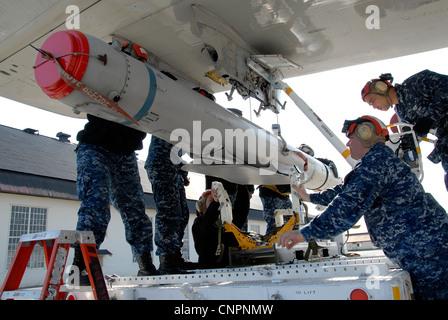 NAVAL AIR FACILITY MISAWA, Japan (April 21, 2012) – Aviation Ordnanceman team, attached to Patrol Squadron (VP) - Stock Photo
