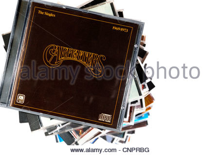 The Carpenters album The Singles 1969-1973, piled music CD cases, England. - Stock Photo