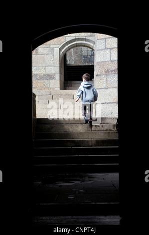 boy running on granite stone steps,arc, arch, archway, boy, child, childhood, infant, joy, joyful, kid, life, lifestyle, - Stock Photo