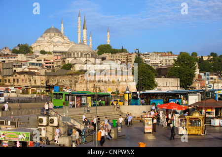 City life in historic district of Istanbul with Suleymaniye Mosque at the far end in Turkey. - Stock Photo