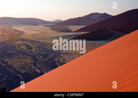 Sunrise from the top of the 80m-high Dune 45 in Sossusvlei, southern Namibia, Africa - Stock Photo