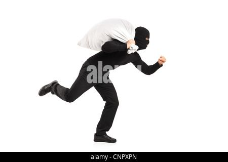 Thief carrying a bag and running away isolated on white background - Stock Photo