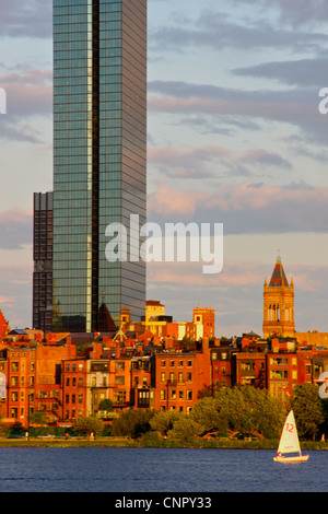 Boston's John Hancock Tower in late summer sunlight with Back Bay neighborhood and Charles River in the foreground - Stock Photo