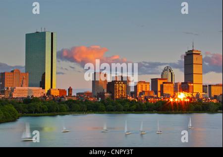 Charles River sailboats and Back Bay, Boston at sunset - Stock Photo