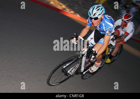 SCOTTSDALE, AZ - OCTOBER 2: Cyclists compete in the Scottsdale Cycling Festival Criterium, a high-speed circuit - Stock Photo
