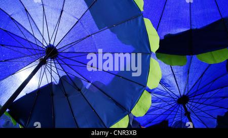 lose up of blue umbrellas background - Stock Photo