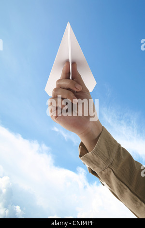 Paper Plane Holding woman hands on sky - Stock Photo