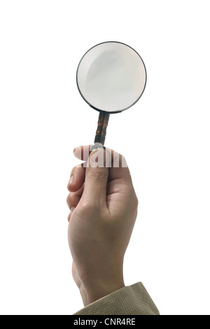 Female hand holding the magnifying glass on white - Stock Photo