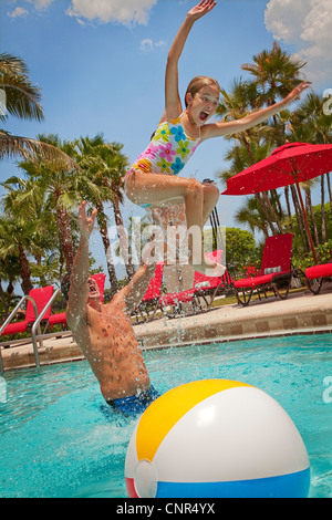 Father Tossing Daughter into Pool, PGA National REsort and Spa, Palm Beach Gardens, Florida, USA - Stock Photo