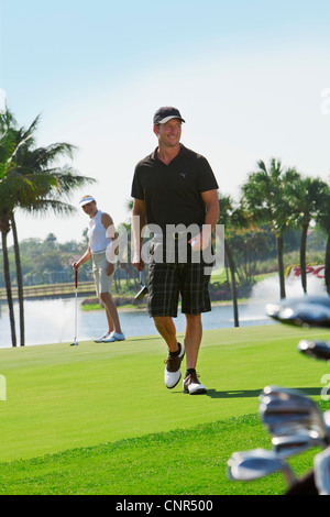 Golfers on Putting Green, PGA National Resort and Spa, Palm Beach Gardens, Florida, USA - Stock Photo