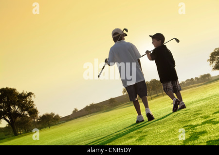 Boys on Golf Course, PGA National Resort and Spa, Palm Beach Gardens, Florida, USA - Stock Photo