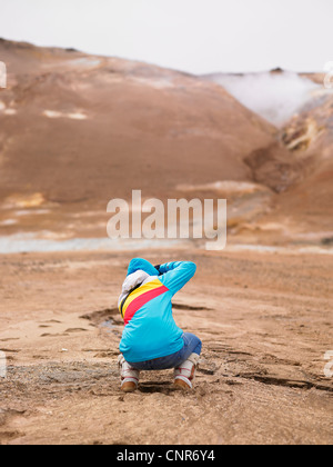 Photographer shooting in rural landscape - Stock Photo
