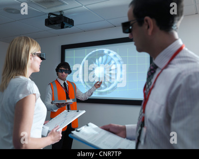Scientists wearing 3D glasses in lab - Stock Photo
