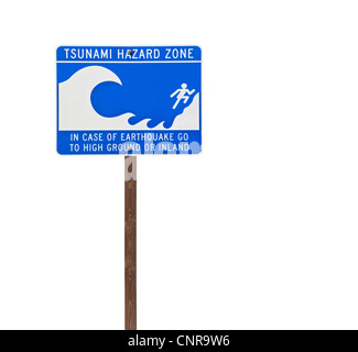 Tall isolated tsunami sign on a wooden post. - Stock Photo