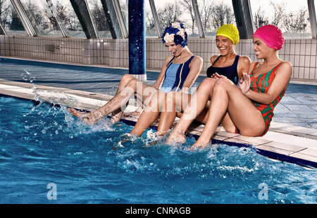 Women playing in indoor pool - Stock Photo
