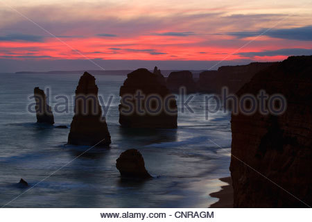 Twelve Apostles - sunset at the sandstone rock formations of famous Twelve Apostels, which are sculpted by the relentless - Stock Photo