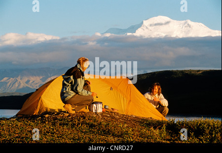 campers in front of the highest mountain of Nort America, Mt. McKinley, USA, Alaska, Denali Nationalpark - Stock Photo