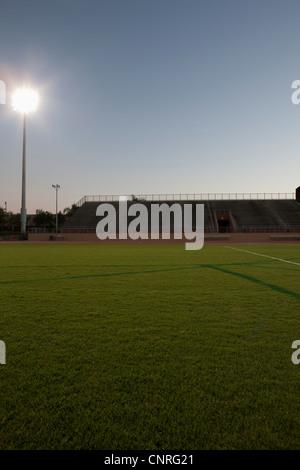Empty sports field and stadium - Stock Photo