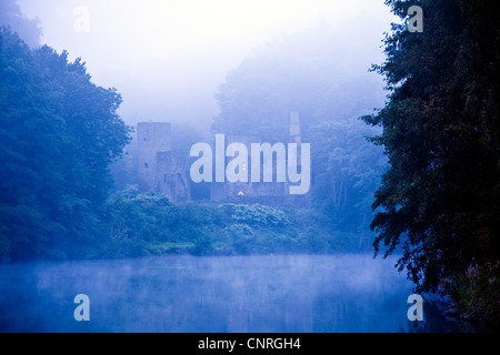 ruin of Hardenstein castle in the morning mist of Ruhr river, Germany, North Rhine-Westphalia, Ruhr Area, Witten - Stock Photo