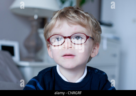 Little boy looking away in thought, portrait - Stock Photo