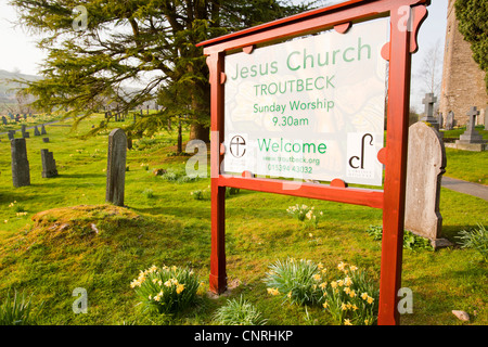 Jesus Church in Troutbeck, Lake District, UK, with wild Daffodils flowering in the church yard. - Stock Photo