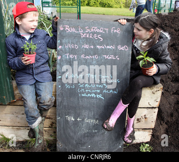 Child gardeners at the Grow Community Garden, Waterworks, Belfast, Northern Ireland - Stock Photo