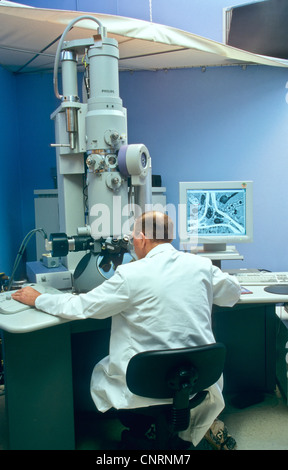 Transmission Electron microscope, scientist/researcher. - Stock Photo
